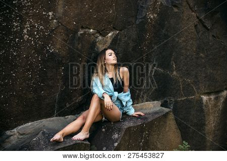 Resting After Long Way Hiking. Pretty Woman Relax In Mountains On Idyllic Summer Day. Sexy Woman Sit