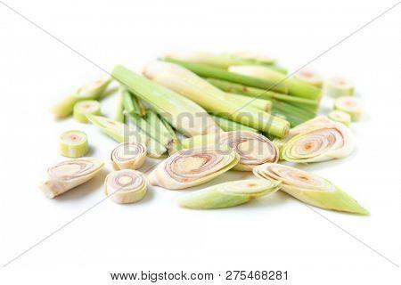 Fresh green lemongrass slices isolated on white background.
