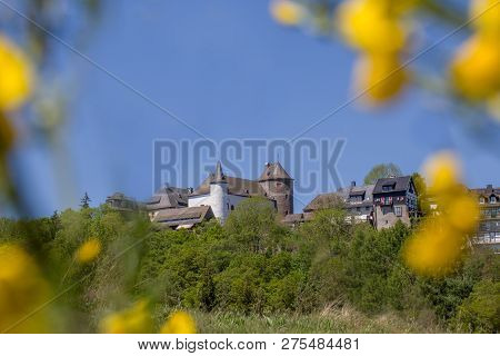 Burg In Wildenburg ,castle In The Morning With Blue Sky And Yellow Flowers, Germany.  Castle With Ni
