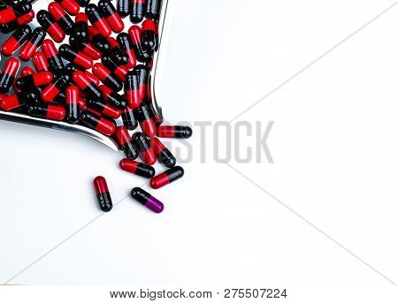 Red-black Capsule Pills On Drug Tray. Antibiotics Drug Resistance. Global Healthcare. Antimicrobial