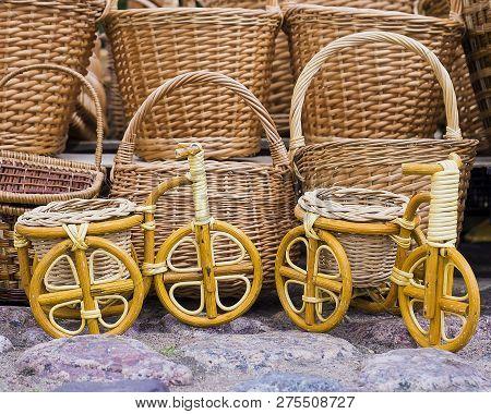 Various Wickerwork Baskets Bikes On The Background