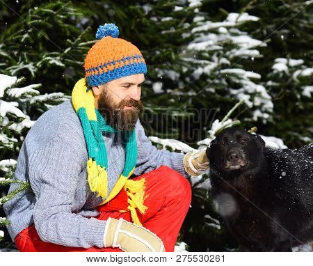 Friendship And Allegiance Concept. Man Wears Knitted Hat, Scarf, Gloves