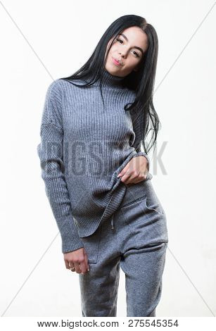 Female knitwear. Fashionable knitwear. Knitwear concept. Feel warm and comfortable. Woman wear grey textile suit blouse and pants. Warm comfortable clothes. Casual style fashion for every day poster