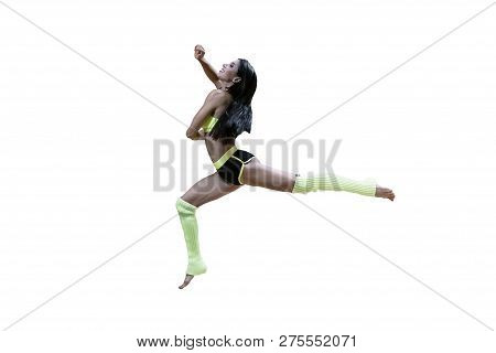 Smiling Dancer In Sportswear Jumping High Isolated On White. Brunette In Yellow And Black Clothes An