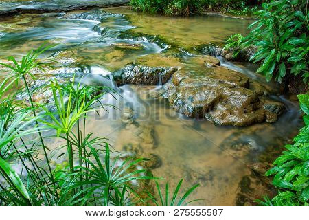 Beautiful Small Waterfall In The Deep Forest In Thailand.
