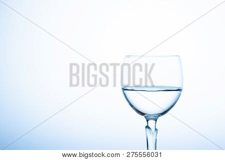 Water Splashing In The Luxury Wine Glass Close Up.  Concept Of Good Healthy And Refreshment.  Copy S
