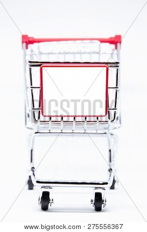 Common Stainless Shopping Cart With Empty Space For Text Or Editing Close Up.