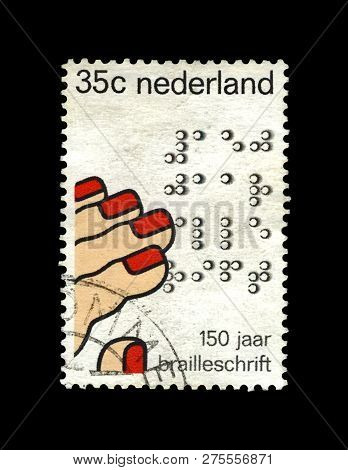 Netherlands  - Circa 1975: Canceled Stamp Printed In Netherlands Shows Fingers Reading Code By Louis