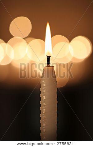 White Candle On Dark Background