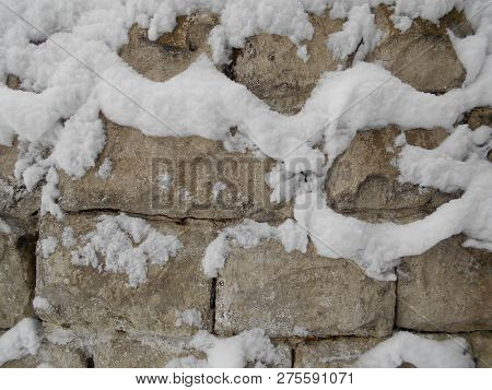 Laying Stones In The Winter In The Snow. Old Wall. Stock Photo Image