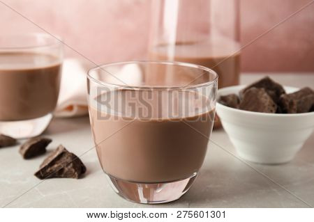 Glass With Tasty Chocolate Milk On Table. Dairy Drink
