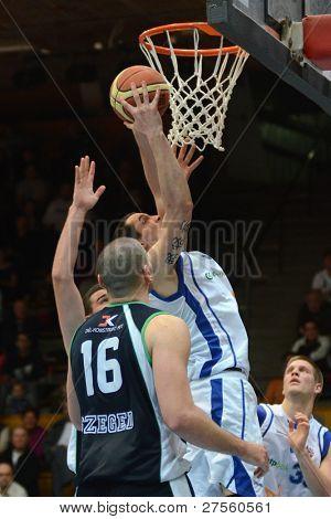 KAPOSVAR, HUNGARY - DECEMBER 10: Unidentified players in action at a Hungarian Championship basketball game Kaposvar (white) vs. Szeged (blue) on December 10, 2011 in Kaposvar, Hungary.