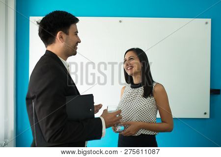 Portrait Of Cheerful Young Colleagues Or Partners Laughing In Boardroom. Caucasian Businesswoman And