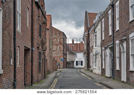 York, England - April 2018: Old Brick Buildings Along Ogleforth Street Towards Chapter House Street