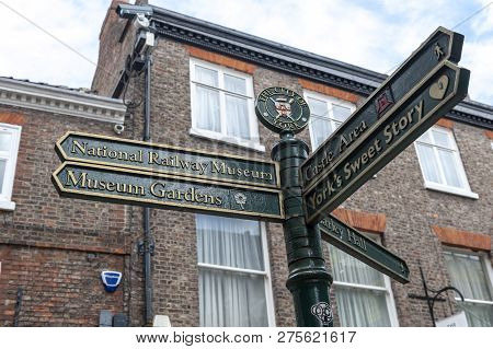 York, England - April 2018: Direction Signpost On Street In Historic District Of City Of York, Engla