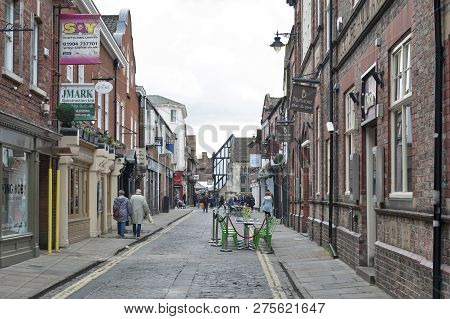York, England - April 2018: Old Brick Buildings Housing Shops And Restaurants Along Swinegate Street