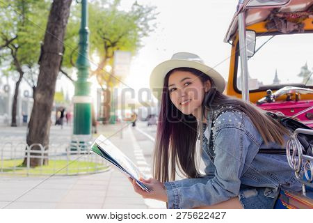 Beautiful Young Tourist Woman Taking A Rest On Tuk Tuk Taxi And Finding Some Tourist Attraction On M