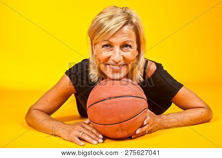 Cute Blond Woman With A Ball Shot In Studio