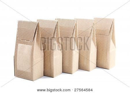 Row Of Boxes From The Goffered Cardboard On A White Background