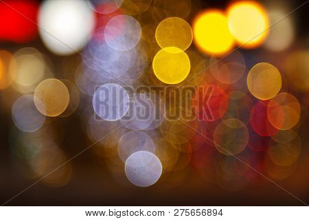 Blurred Background Of Colored Lights. Image Of Abstract Blurred Bokeh Background With Warm Colorful