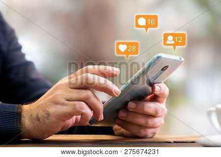 Man Checking His Social Media Account Using Smart Phone