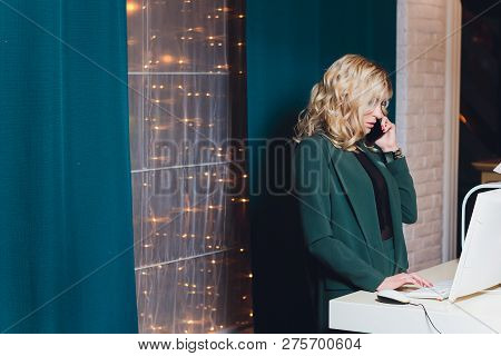 International Cooperation. Blonde-haired Manager Of International Cooperation Looking At The Map On