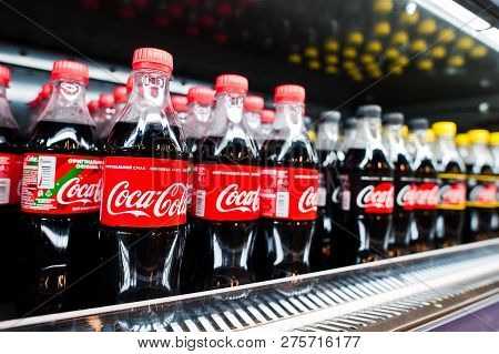 Kyiv, Ukraine - December 19, 2018: Plastic Bottles Of Coca Cola On Fridge On Stand At Supermarket. C