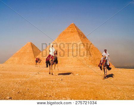 Giza, Egypt - May 23, 2017: People Near The Sights Of Egypt. Tour Of The Ruins Of Ancient Egypt.