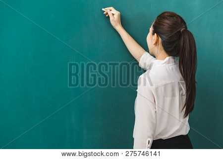 Asian Teacher Chalk On Green Board, Concept For Classroom.