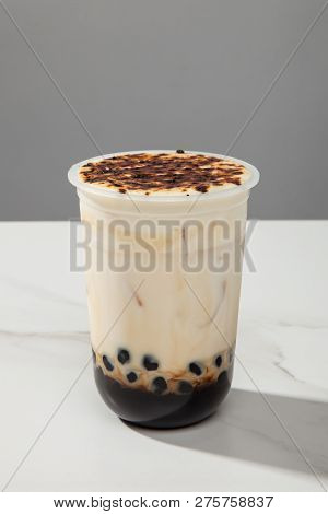 Brown Sugar Pearl Milk Tea In A Transparent Glass