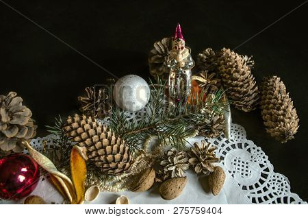 Corner Of Paper Openwork Napkin With Various Coniferous Cones, A Coniferous Twig, Old Worn Christmas
