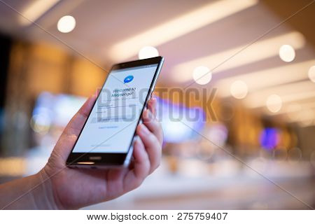 Chiang Mai, Thailand - August 03,2018: Woman Hands Holding Huawei With Facebook Messenger App On Scr