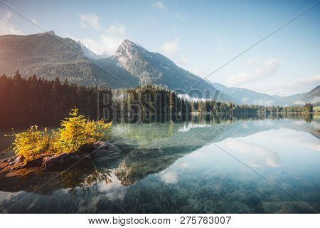 Famous alpine lake Hintersee. Location resort Ramsau, National park Berchtesgadener Land, Upper Bavaria, Germany Alps, Europe. Scenic image of popular tourist attraction. Explore the beauty of earth.