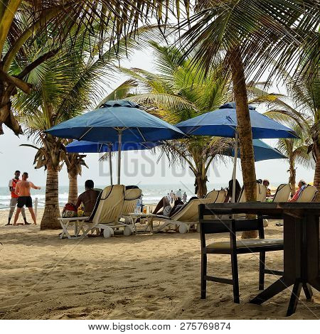 Relax On A Stunning Beach Under Palm Trees. Exotic Resort. Sun Beds And Umbrellas. Sweet Memories Ab