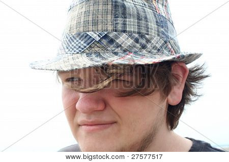 Thoughtful Teen Boy In Plaid Hat