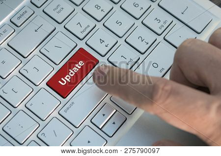 Customized Concept With Computer Enter Button On Keyboard: Update. A Male Finger Presses A Color But
