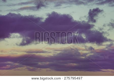 Dramatic Sunset With Clouds Of Dark Tones In The Blue Sky. Natural Composition. Dark Toned Sky. Even