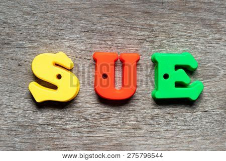 Color Alphabet Letter In Word Sue On Wood Background