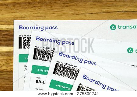 Amsterdam, The Netherlands - December 26, 2018: Four Transavia Airlines Boarding Pass Tickets.