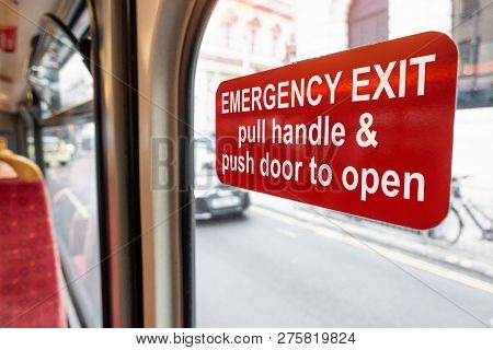 Red Emergency Exit Door Sign On The Back Of The Public Bus For Open In Case Of Emergency. Pull Handl
