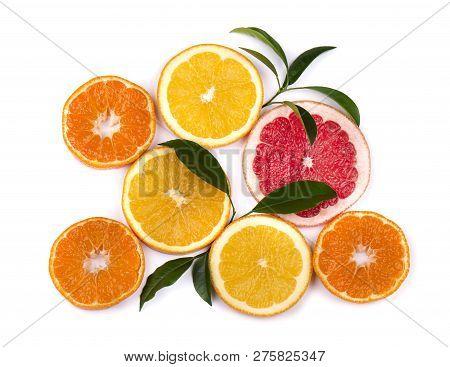 Citrus Fruits Isolated On White Background. Isolated Citrus Fruits. Pieces Of Mandarin, Pink Grapefr