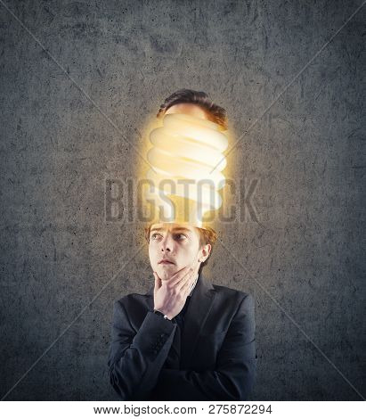 Thoughtful Businessman With His Head Divided Have An Lightbulb Inside.