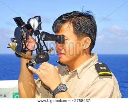 Navigation Officer Manages Sextant