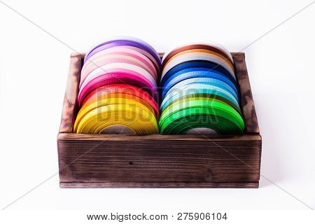 ribbon bobbins in box isolated on white poster
