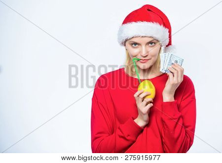 Symbol Of Wealth And Richness. Rich Girl With Lemon And Money. Lemon Money Concept. Girl Santa Hat D