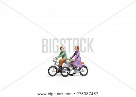 Miniature People : Couple Ride Bicycle On White Background