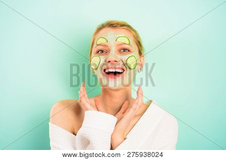 Happy Woman With Facial Mask On Face. Beauty Treatments. Facial Clay Mask. Spa. Cosmetic Mask. Beaut