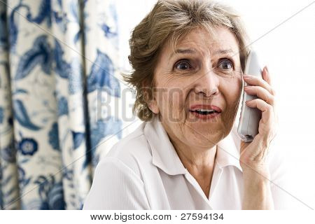 Happy senior woman talking on phone