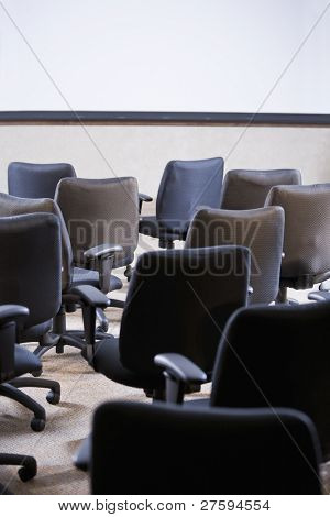 Room full of empty office chairs, rear view