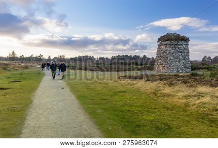 Culloden Battlefield, Scotland - December 28, 2018: Visitors At The Memorial Cairn, On Culloden Batt